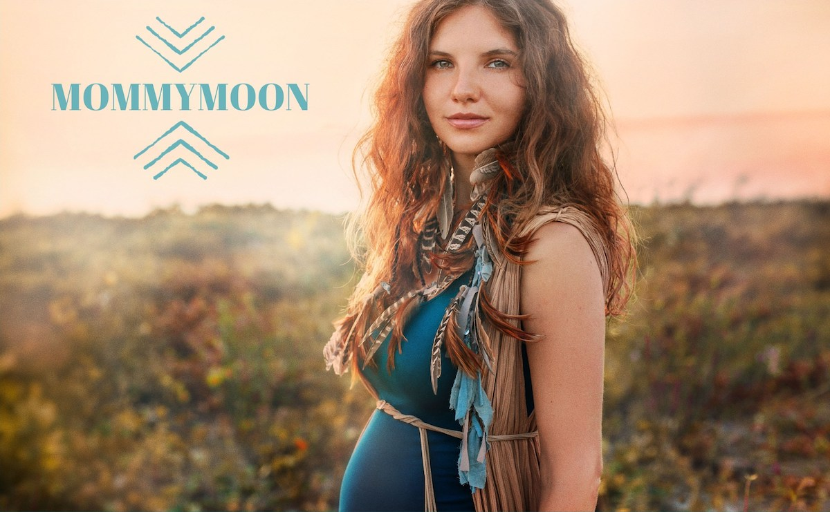 Mommymoon logo next to pregnant person with landscape background