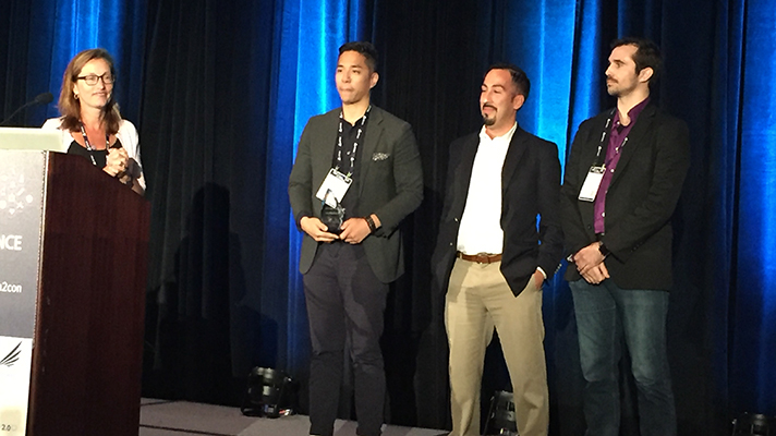 The three finalists of the RWJF's AI Challenge pose together on stage at Health 2.0
