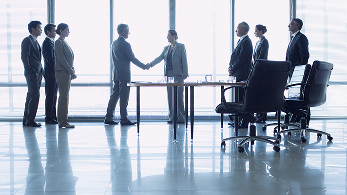 Business people shaking hands in a conference room