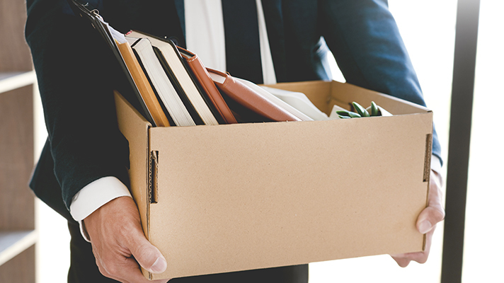 Businessperson carrying a box