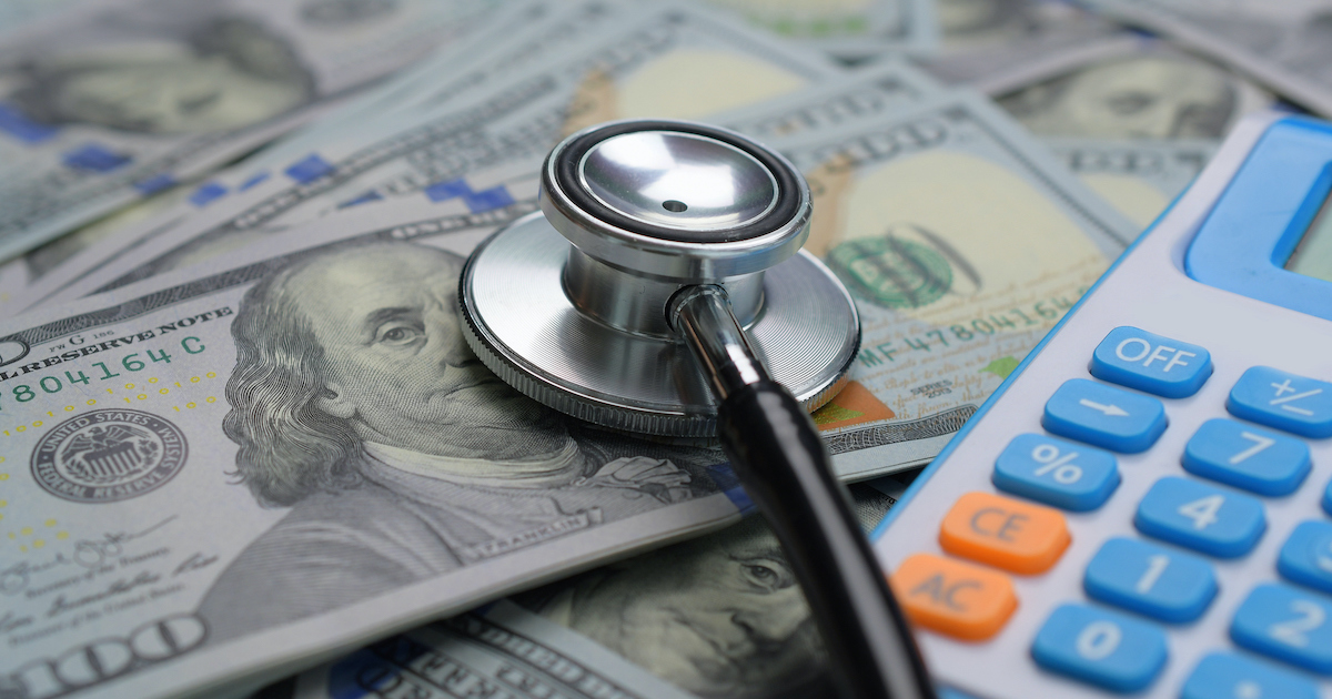 Stethoscope, money and a calculator.
