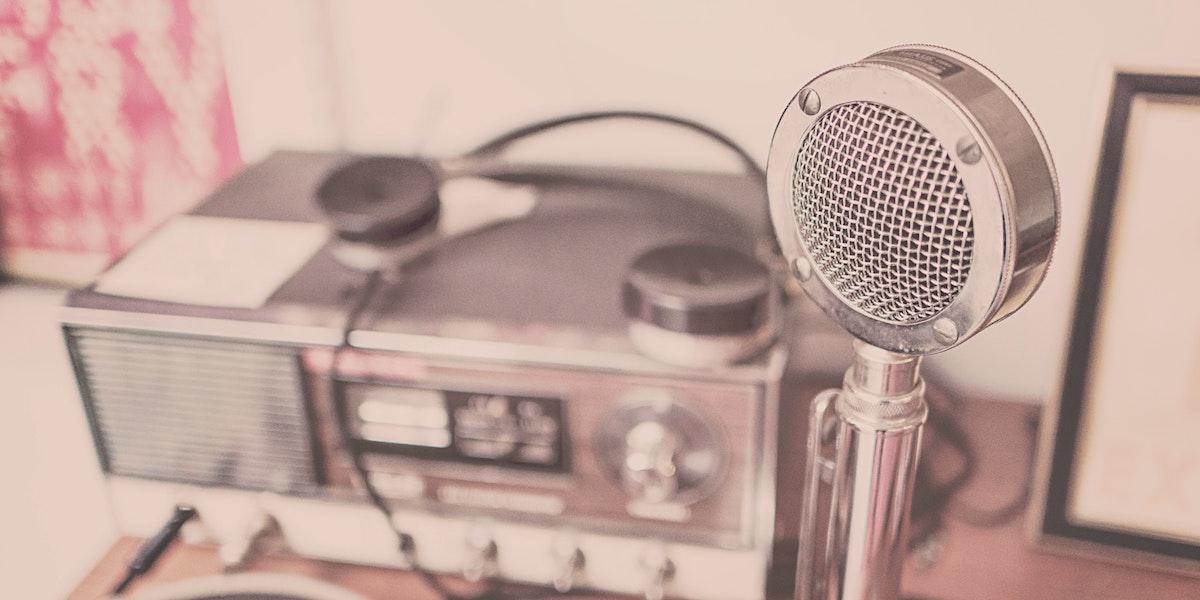 An old-time radio and circular microphone