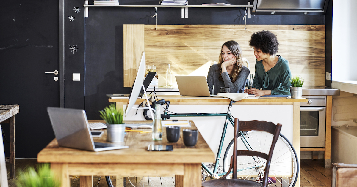 Two workers at a desk