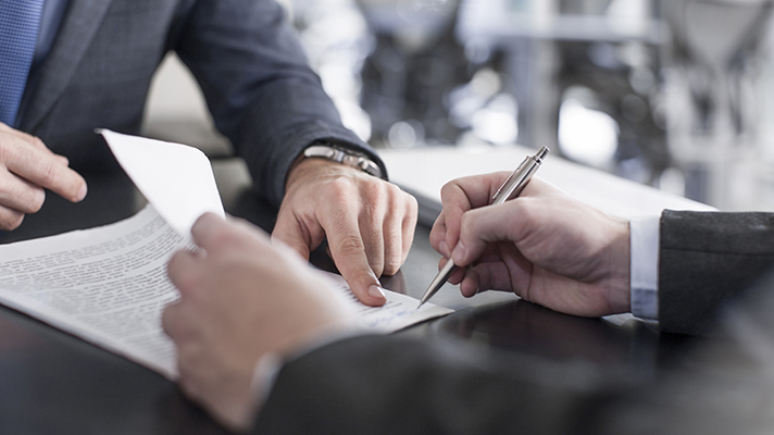 Person signs document