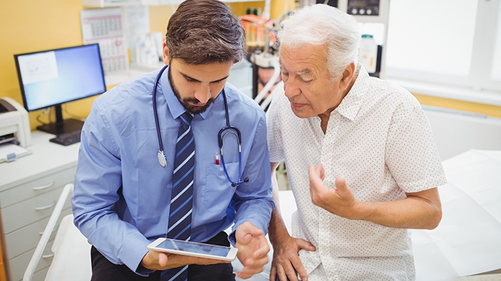 doctor talking with patient healthcare technology