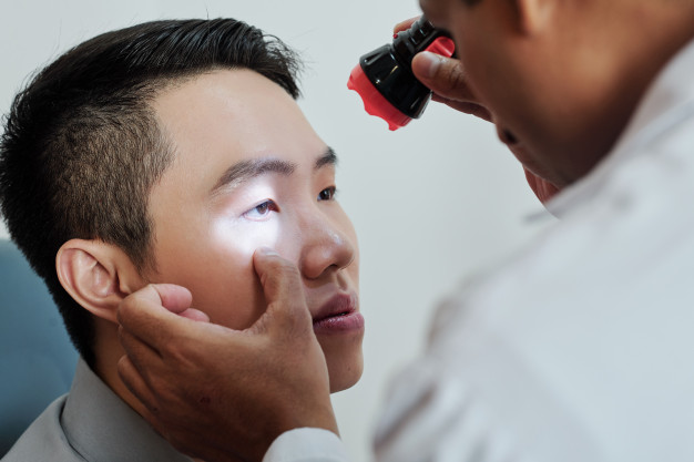 A patient having his eyes examined.