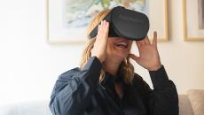 A person uses an AppliedVR-branded virtual reality headset