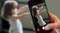 Caregiver records child on smartphone using Cognoa's Canvas Dx diagnostic software