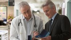 Doctor and executive sharing information