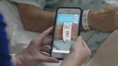 nurse scanning hospital patient bracelet with smartphone