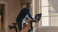 Person works out on a cycling machine