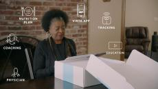 Woman unboxing Virta Health kit