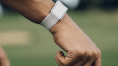 The Whoop device on a wrist