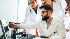 Clinicians looking at screens