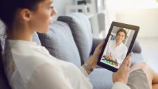 Patient using telehealth to talk to a healthcare professional on a tablet
