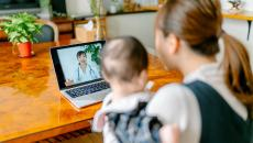 Mother consults doctors via telehealth with her baby