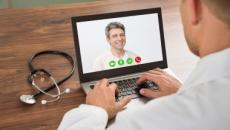 A provider conducts a telemedicine visit through a laptop