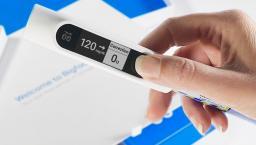 Hand holding Bigfoot rapid-acting smart insulin pen