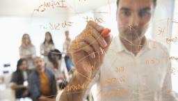 Man demonstrating math formula.