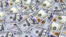 A pile of hundred dollar bills