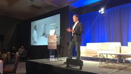 Sam Inkinen speaking on stage at Health 2.0