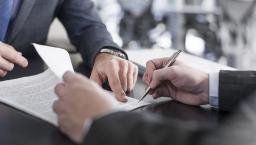 Executives sign a contract