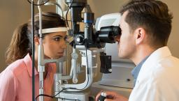 patient eye exam with doctor