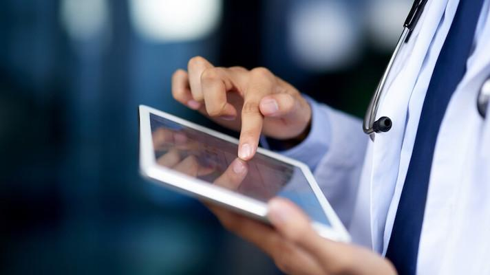 Healthcare personnel uses a tablet