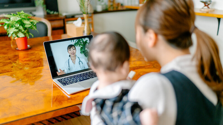 Patient and child attending telehealth appointment