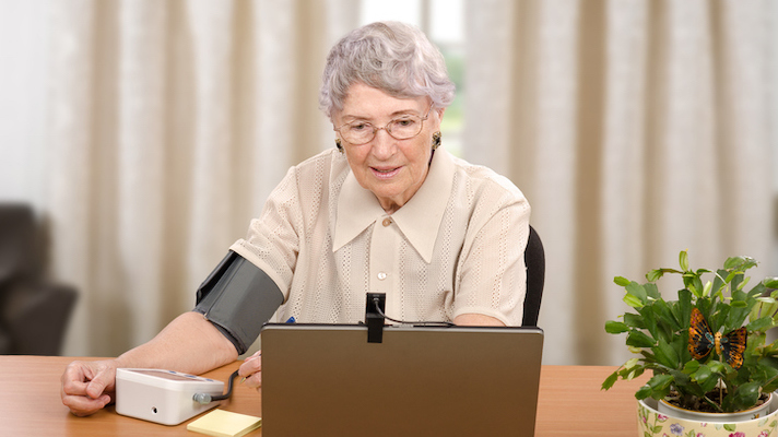 An older woman using telemedicine.
